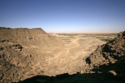 An aerial view across the circa 2500 tombs of Wadi UatUat, a large desert area between two high cliffs