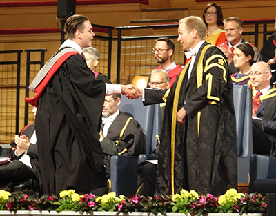 graduate shaking hands with VC