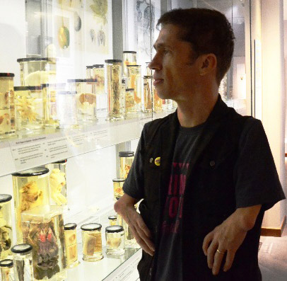 Mat Fraser looking at specimen jars