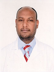 Image of Dr Zelalem Gashaw, wearing a white lab coat, blue shirt, and a striped tie