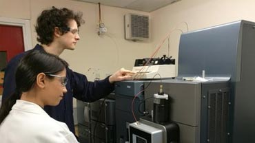 student working with a mass spectrometer