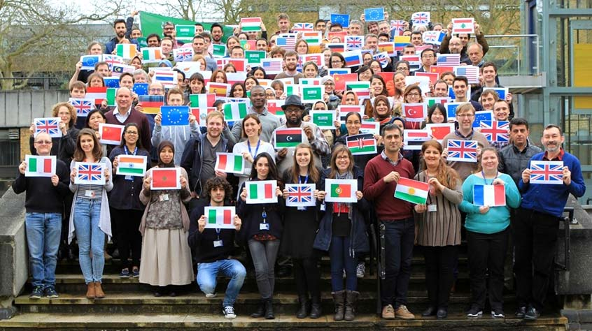 all staff from the Department of Genetics and Genome Biology holding flags