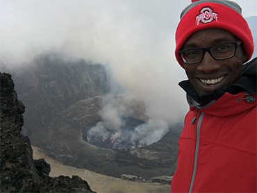 professor christopher jackson with nyiragongo (volcano) behind