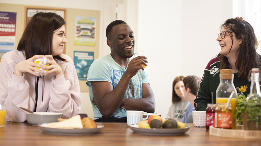 Students eating breakfast in student accommodation