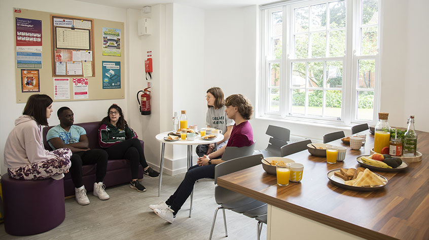 Students socialising in their communal area of student accommodation