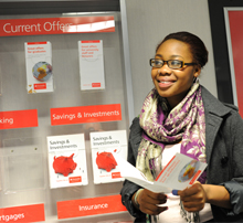 Student reading a leaflet in a bank