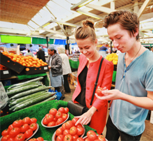 Students shopping for tomatoes at Leicester Market