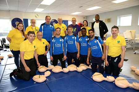 Leicester City footballers with CPR equipment