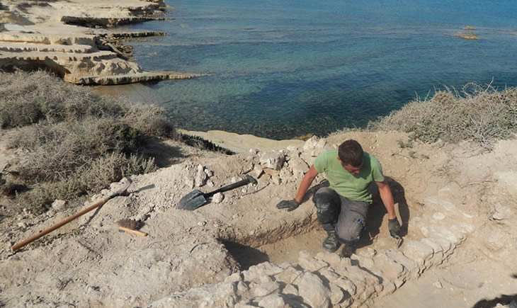Student on an archaeological dig at the coast