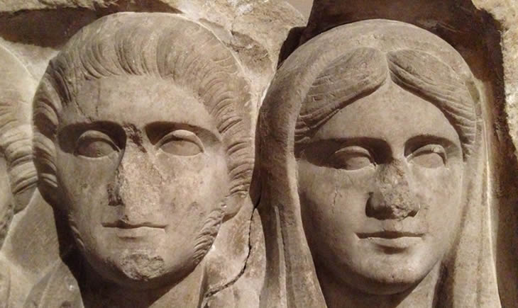 Close up of ancient stone carvings of faces