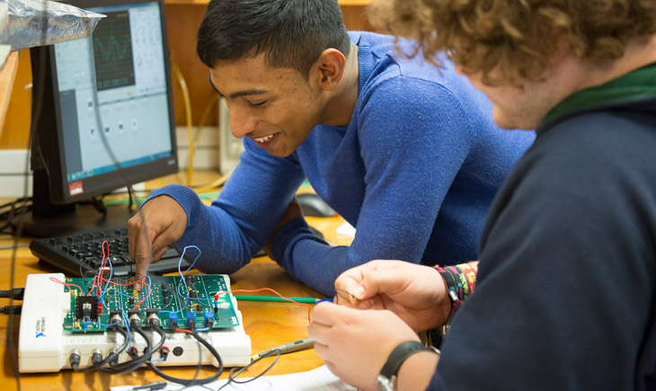 Students with circuit board