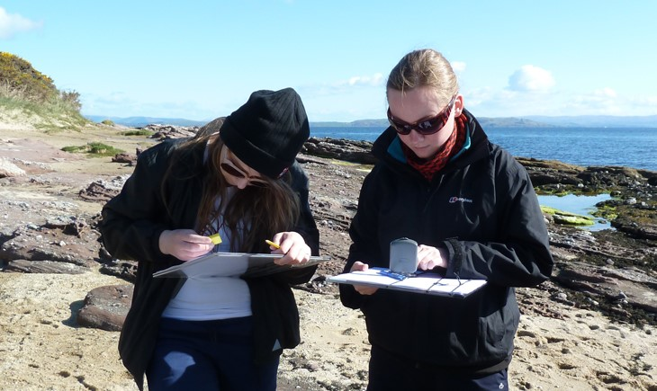 geology students on rocky beach