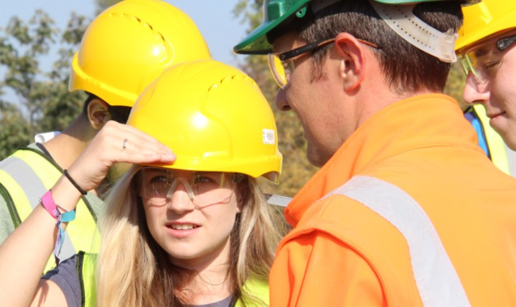 geology student in hard hat and safety glasses