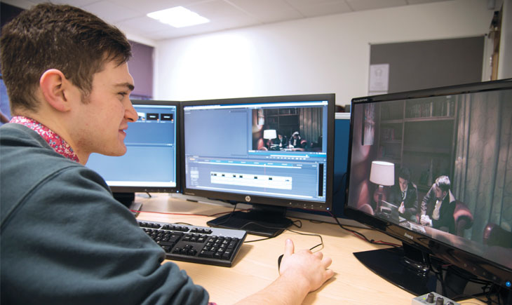 Student editing a film on a computer screen