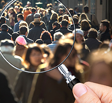 people on the street through a magnifying glass