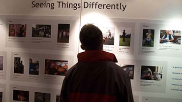 A person viewing an exhibition about disability