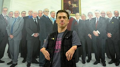 Mat Fraser standing in front of a painting